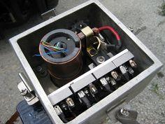 Slip ring shown with brushes and brush holders from a 300amp starter motor rebuild kit.