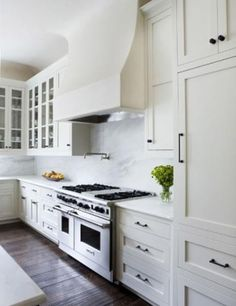 White chi chi kitchen! Carrara carrera marble backsplash & countertops counter tops, white IKEA kitchen cabinets with oil bronzed pulls by ina