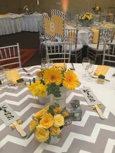 Grey and yellow centerpieces