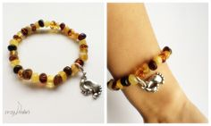 Round amber beads bracelet with baby and mom foots charm by CozyAmber on Etsy https://www.etsy.com/listing/252777353/round-amber-beads-bracelet-with-baby-and