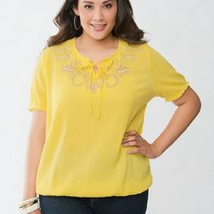 "Lane Bryant Yellow Embroidered Peasant Top 18/20 '100% COTTON MACHINE WASH LENGTH: 29.5"" SIZE 18/20 Flirty and feminine peasant top takes on a charming new attitude with playful floral embroidery and ruffled short sleeves. Made to flatter with a tied scoop neckline and forgiving bubble hem, this soft & lightweight gauze top is a must for warm-weather style.' In great used condition. Bust 24"" across, not much stretch. Model shot from LaneBryant.com. ::: Bundle 3+ items from my closet & save…"