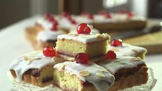 Take the classic bakewell tart recipe and make it into a tray bake in this recipe. A golden layer of shortcrust pastry topped with an almond cake, strawberry jam, icing and glacé cherries. Tray Bake Recipes, Tart Recipes, Easy Cake Recipes, Baking Recipes, Bakewell Traybake, Cherry Bakewell Tart, Bakewell Pudding, Kid Desserts, Delicious Desserts