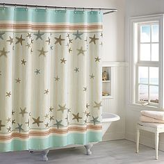 You'll feel beachy no matter the season with the beautiful starfish pattern on this Tremiti Shower Curtain. Soft turquoise and coral stripes border an exiting display of matching starfish and stripes.