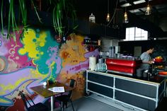 If you go down in the commercial woods of Fortitude Valley you're sure to find Bear Bones Espresso, a funky stencil art warehouse and coffee roastery.