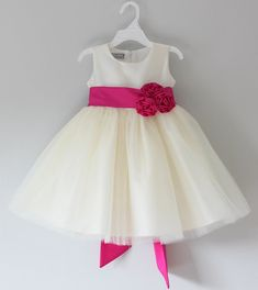This beautiful dress is available in size newborn to size 16    Taffeta fabric  Fitted bodice  Sleeveless  Three layers of soft tulle skirt