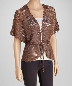 Slip into this sleek cardigan for sensational style that doesn't sacrifice comfort. Boasting lovely crocheted construction with a hint of shimmer and a convenient front tie closure, this chic piece is sure to become a fast favorite.