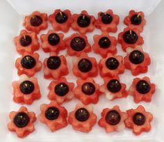 Watermelon flowers. Daisy-shaped watermelon slices, with grape centres, held together with half a toothpick. #inthenightgarden #partyfood #kidsparty #easybreezyparties