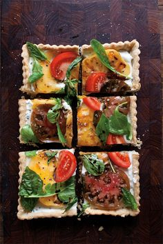 A stunning tart that showcases summer's succulent tomatoes. It's also extremely simple to make–especially if you have pastry at the ready in your freezer.  Choose an array of differently colored heirlooms if you can find them.              Goat Cheese, Herb and Heirloom Tomato Tart