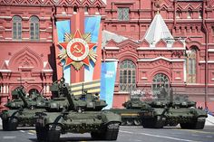 Russian T-90 tanks roll at the Red Square during a Victory Day parade on May 9, 2014 in Moscow, Russia. Russia marked the Victory Day on May 9 holding a military parade at Red Square.