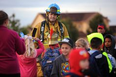 Jon Mueller, firefighter and paramecia from Colorado Springs Fire Department, gathers with students at Ken Jordan Park during a Walk to School Day event Oct. 8 near Imagine Indigo Ranch in District 49. More than 150 children, kindergarten though eighth-graders, participated from the charter school. Roughly 70 joined the group's route. Teachers had been discussing route safety in classrooms.