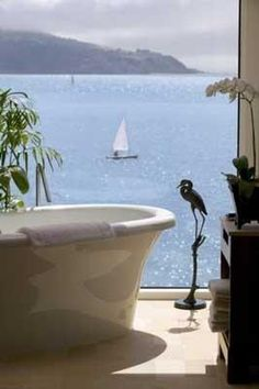 Stunning Bathroom with amazing view of the water.Bathroom at The Inn Above Tide in Sausalito, California.