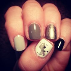 Grey ombre with unicorn stamp nail art.