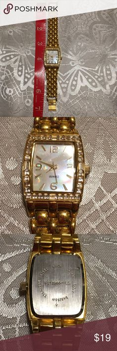 "Avon Mother of Pearl and baguette crystal watch Avon goldtone Mother of Pearl and baguette crystal watch.  Can be dressy or worn every day.  This was sized by a jeweler to fit up to a 6"" wrist.  I gained a little weight and even my wrists got plump🙄.  I store my watches with the crown pulled out to preserve the battery.  This has recently had the battery replaced prior to my realization it doesn't fit😢.  EUC. Avon Accessories Watches"