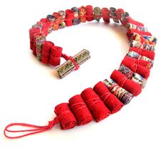 Gilgulim ~ fabric rolled beads with intriguing assembly. Looks to be cord slip-stitched around each bead . Rope Jewelry, Jewelry Crafts, Beaded Jewelry, Jewellery, Fabric Beads, Paper Beads, Textile Jewelry, Fabric Jewelry, Fabric Necklace