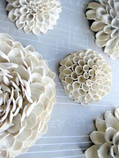 Gorgeous white ceramic dahlias. How awesome would a wall of these be?
