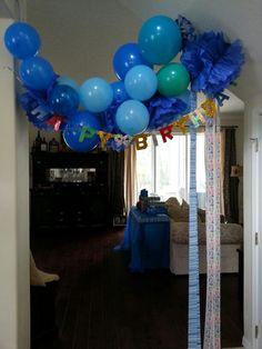 Happy Birthday tissue flowers and balloon banner.