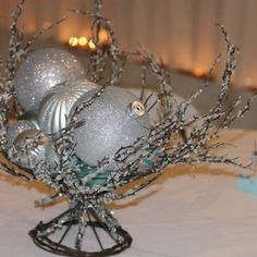 Could incorporate silver (or silver and blue) christmas ornament balls. This is great because they would also be on sale after the holidays! Blue Christmas, Christmas Bulbs, Winter Wonderland Centerpieces, Blue Sapphire, Balls, Holidays, Holiday Decor, Silver, Diy