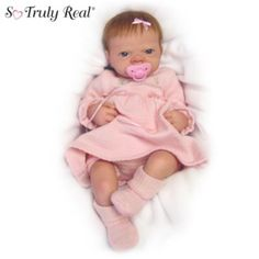 Exclusive! The lifelike Linda Webb doll that won the hearts of the world! Adorable outfit, RealTouch™ vinyl skin, removable pacifier.