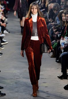 The models at 3.1 Phillip Lim earned their brownie points this AW16, storming the catwalk in gorgeous rust-coloured velvet suits layered over white roll necks and paired with caramel patent boots