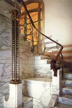 Interior view of the main stair in the Art Nouveau style Horta house. Photo from a 1980's Horta Museum postcard.