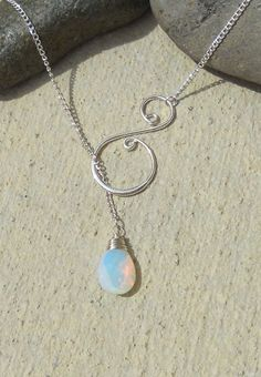 Silver wire wrapped gem with swirl, lariat necklace – 15 gems to choose from, handmade jewelry. $19.75, via Etsy.