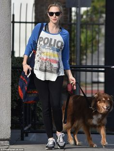 Walking in her footsteps: The actress took her beloved rescue dog Finn out for a walk while wearing a Synchronicity T-shirt