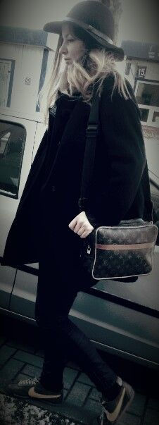 Street fashion black coat with lv bag and nike shoes