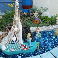 #miniaturegarden #fairygarden #beachgarden Beach theme fairy garden,  Mermaid garden