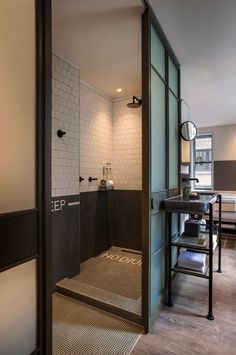 Hotel room in the Moxy Times Square hotel | custom slim vanity of volcanic stone by Pyrolave