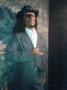 standing with a fashionable black hat wax statue. Wax Statue, Snoop Dogg, Hat, Cool Stuff, Celebrities, Music, Image, Collection, Black