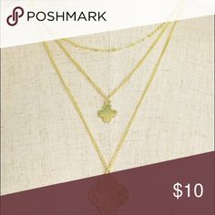 "Gold Four Leaf Clover Necklace Three chain gold necklace with two different four leaf clover pieces on two of the  chains.   Description: LENGTH: 12""  ❌Trades ✅ Price Firm ✴️ Bundles Save 20% 💟 Also available in Silver Jewelry Necklaces"