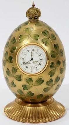 "THEO FABERGE ENAMEL EGG WITH CLOCK, H 5 1/4"":Signed T. Faberge #150. Pedestal base, crown finial. Original box (Theo Fabergé (London, 26 September 1922 - 20 August 2007) was the grandson of Peter Carl Fabergé. )"