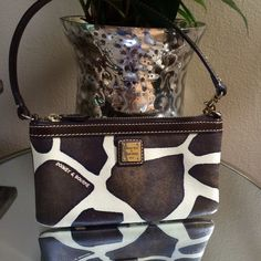 DOONEY & BOURKE clutch Just stunningly beautiful preloved in excellent conditions Dooney & Bourke Bags Clutches & Wristlets