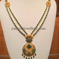 Jewellery Designs: Temple Design Emerald Floral Long Chain