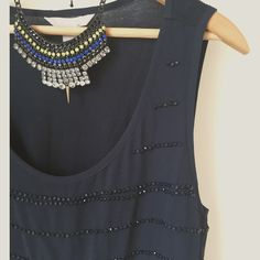 Banana Republic beaded top Pretty and elegant navy blue beaded top. Beautiful condition, no beads missing. Color is rich navy blue, much prettier in person - the color was difficult for me to capture in photos. Please ask for any and all questions :) Sorry  No trades but all reasonable offers are welcome :) Banana Republic Tops Tank Tops