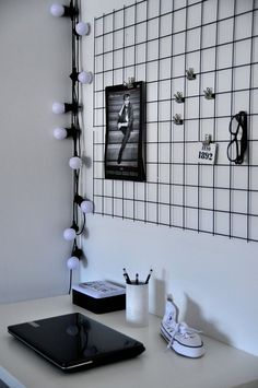 Inspiration only Wire grid wall. Place above a desk in a small office. Clip on notes, photos, pictures, mementos, etc. using metal clips or clothes pins.
