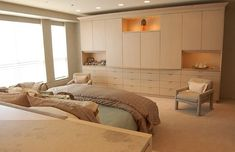 Gorgeous master bedroom with custom wall of wardrobes