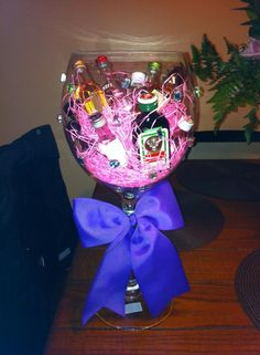 glue stones on a huge wine glass, toss in some mini bottles with candy & easter string Alcohol Gift Baskets, Liquor Gift Baskets, Alcohol Gifts, Raffle Baskets, Mini Alcohol Bouquet, Liquor Bouquet, Candy Bouquet, Holiday Fun, Holiday Gifts
