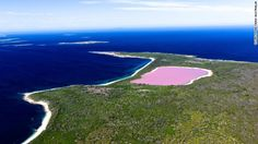 Australia's Lake Hillier stays filled with perfectly pink water whether day or night and keeps its hue even if taken away in a bottle.