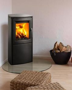 The Varde Aura 2 is the larger of the square shaped Varde Stoves, it has the same firebox as the Varde 3 but more storage space underneath.