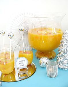 Sparkling Citrus Holiday Sangria Recipe - a perfect big-batch Champagne and fruit cocktail to serve a crowd at your Christmas and end-of-year parties!   BirdsParty.com