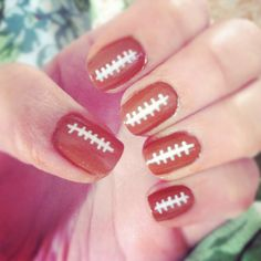 Football Nails! Great for the Superbowl or a big game day.  - Simply paint nails with a chocolate brown or reddish brown, when it dries use a white nail art pen or french tip manicure brush to paint on the lines, with a top coat to finish  =]