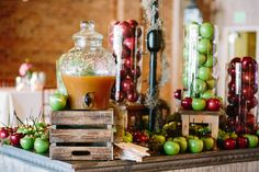 Apple Cider self-serve drink display with hallowed out apples for the cups. Another beautiful fall display at The Venue!