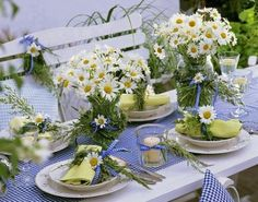 A wedding table covered with daisies