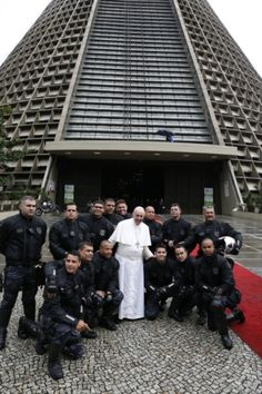 Pope Francis poses with police outside cathedral during World Youth Day visit to Brazil  Pope Francis poses with police officers outside the cathedral in Rio de Janeiro July 25, during his weeklong visit to Brazil for World Youth Day. (CNS photo/Paul Haring)