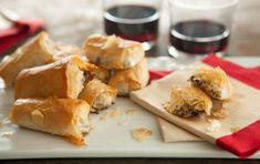 A hidden sliver of Brie bakes up creamy and rich under a spoonful of savory herbed mushrooms in these flaky pastry bites. These easy and impressive hors d'oeuvres promise to be the center of attention at your next cocktail party.