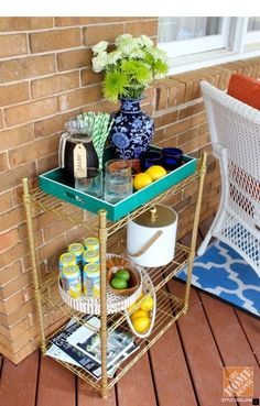DIY Idea: A glamorous facelift for an ordinary shelving unit! All it took was some gold spray paint. Could this be the DIY dream Bar Cart I have been looking for? All You Need Is, Porches, Drink Cart, Beverage Cart, Gold Spray Paint, Diy Bar, Outdoor Living, Outdoor Decor, Outdoor Bars