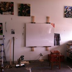 """My double wall mounted easel for holding large canvases or two smaller ones. They can hold a canvas that is 6"""" tall."""