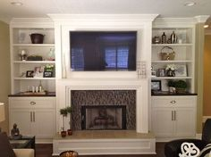 Julie Adama posted Built ins - eclectic - living room - san diego - by Savvy Interiors White paint / dark stain combo to her -For the home- postboard via the Juxtapost bookmarklet. Bookshelves Around Fireplace, Built In Around Fireplace, Fireplace Built Ins, Home Fireplace, Bookshelves Built In, Fireplace Remodel, Fireplace Design, Fireplaces, Modern Fireplace
