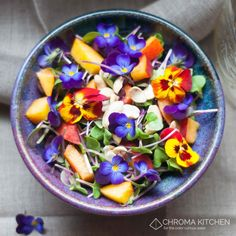Viola Spring Salad  This simple spring salad recipe is a nutritional powerhouse, featuring sweet peaches on a bed of spicy radish micro greens topped with violas, pansies, and raw cashews. The violas, pansies, and microgreens came to me by way of rooftop farm Brooklyn Grange. If you are what you eat, then you might as well eat flowers.   Or be a peach.   Or do both.